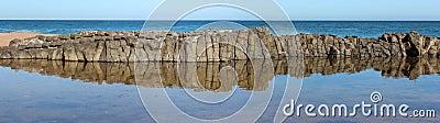 Panorama of  dark  basalt rocks at Ocean beach Bunbury  Western Australia