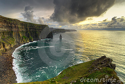 Panorama of irish cliffs at sunset
