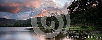 Panorama landscape stunning sunrise over lake with mountain rang