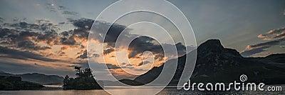 Panorama landscape sunrise over mountain lake