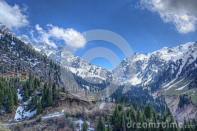Panorama of nature  fir and green mountains, snow and sky in Chimbulak Almaty,  Kazakhstan