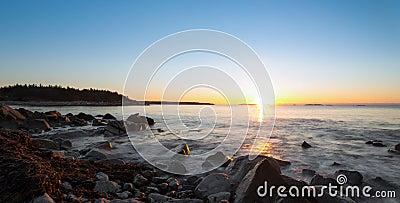 Panorama of winter sunrise at the ocean beach