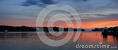 Panoramic sunset and lighthouse