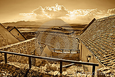 Panoramic view of ancient rural town in sepia