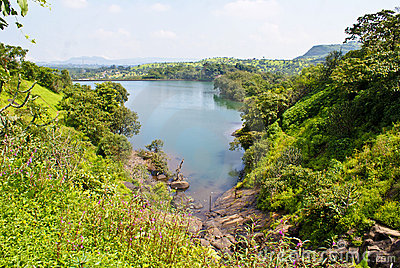 Panoramic view of a lake flanked by greenery