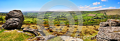 Panormic view of Dartmoor with Widecombe-in-the-Moor in the distance.