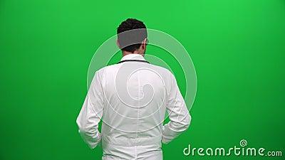 Pantalla del verde del doctor From Behind On almacen de metraje de vídeo