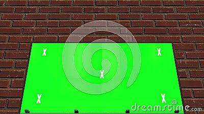 Pantalla verde, cartel con llave croma delante de una pared de ladrillo. Video se burla de publicidad almacen de metraje de vídeo