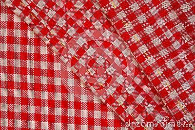 Paño rojo detallado de la comida campestre, fondo para el diseño