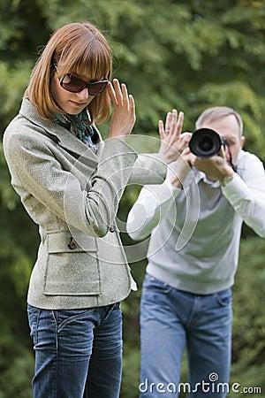 Paparazzi shooting woman