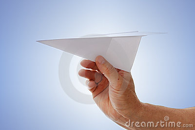 Paper aircraft is launched from hand.