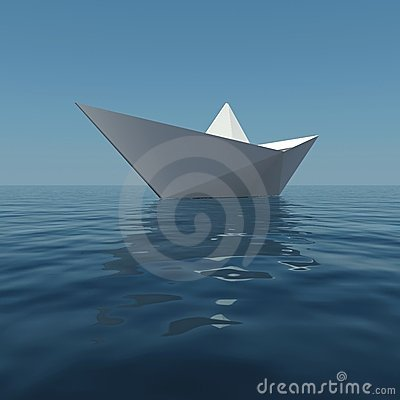 Paper boat in the sea