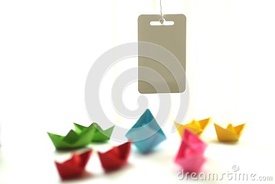 Paper boats. Origami colorful paper ships with blank tag memo or text design. Stock Photo