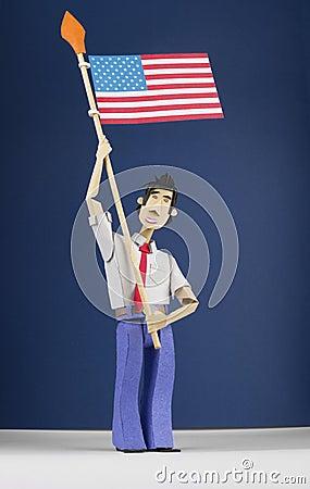 Paper figurine holding USA flag