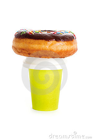 Paper coffee cup and donut