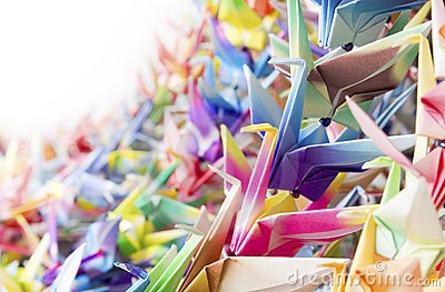 Paper cranes held together by fishing lines