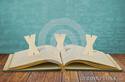 Paper cut of XXX Adult on book