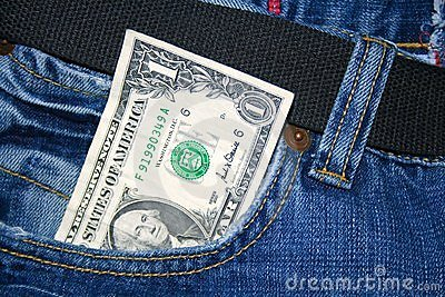 Paper dollar in a jeans pocket