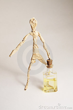 The paper human with bottle of oil