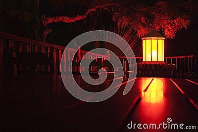 Royalty free stock image: paper lantern lit at night in street cafe