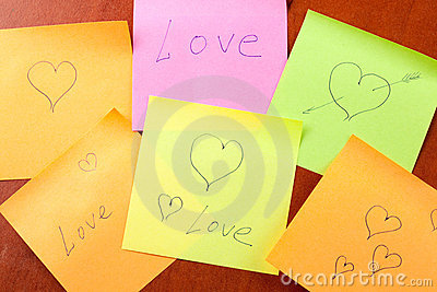 Paper notes with love and hearts