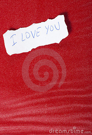 Paper on red background with message of love