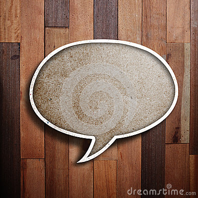 Paper speech bubble on wood