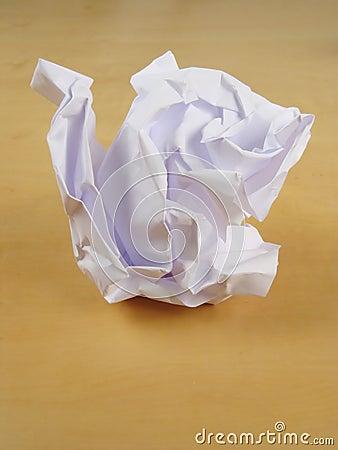 Paper wad on desk