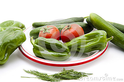 Paprika and cucumbers with tomatoes on plate