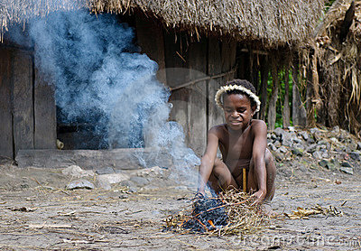Papuan boy making fire, Wamena, Papua, Indonesia Editorial Image