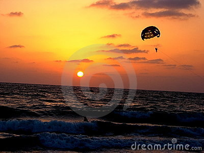 Para-sailing on beach at sunset