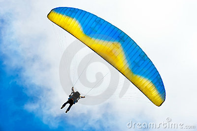 Parachuter descending with instructor