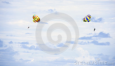 Parachutes on blue sky