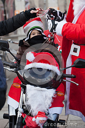 The parade of Santa Clauses on motorcycles around the Main Market Square in Cracow Editorial Image