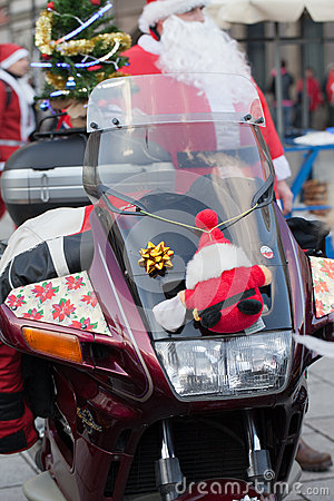 The parade of Santa Clauses on motorcycles around the Main Market Square in Cracow Editorial Photo
