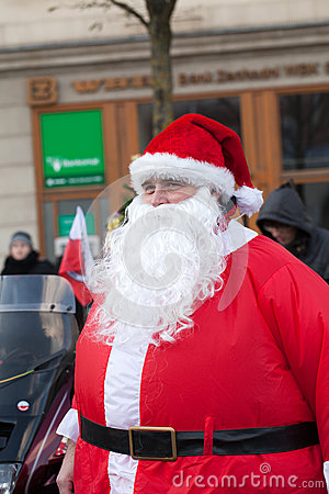 The parade of Santa Clauses on motorcycles around the Main Market Square in Cracow Editorial Stock Image
