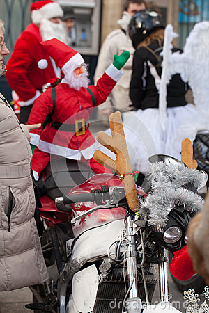 The parade of Santa Clauses on motorcycles around the Main Market Square in Cracow Editorial Photography