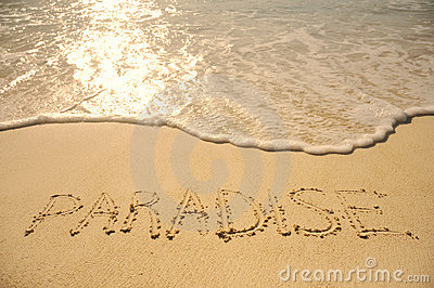 Paradise Written in Sand on Beach