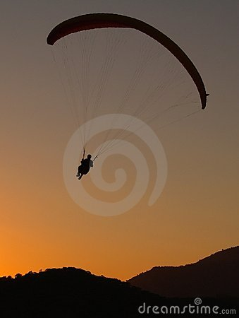 Free Paraglider At Sunset Stock Image - 4859721
