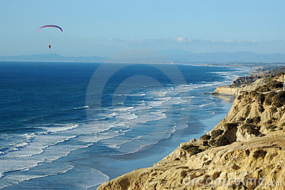 Paraglider in flight over La Jolla Cove
