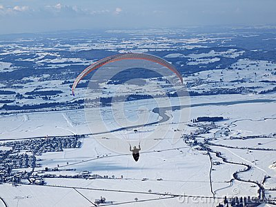 Paraglider flying over a valley in germany