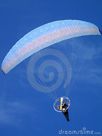 Paraglider over blue sky