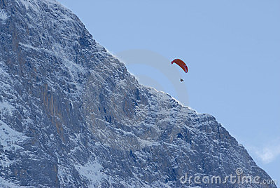 Paraglider over mountain