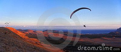 Paragliders at sunset.