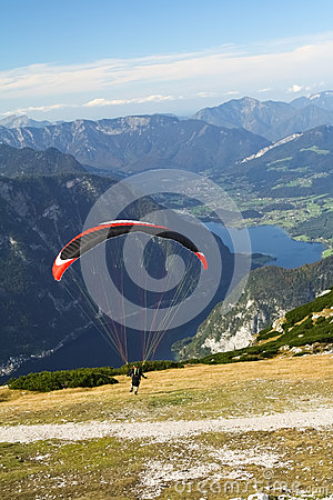 Paragliding above mountain lake