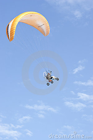 Paragliding enthusiasts flying in blue sky Editorial Image