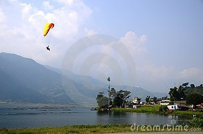 Paragliding over a lake