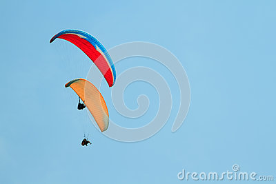 Paragliding over the mountains against sky