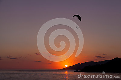 Paragliding at sunset in Oludeniz, Turkey Editorial Stock Photo