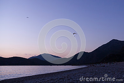 Paragliding at sunset in Oludeniz, Turkey Editorial Photo
